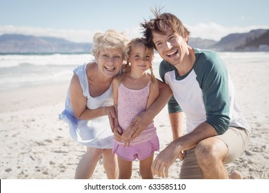 Portrait of multi-generated family at beach during sunny day