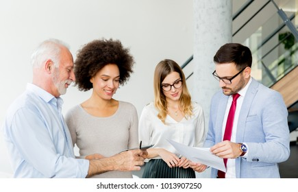Portrait of multiracial business people standing in the office