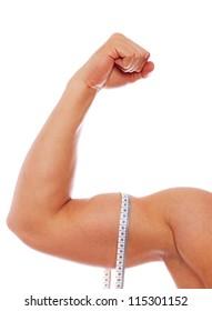Portrait of muscle man biceps posing in studio