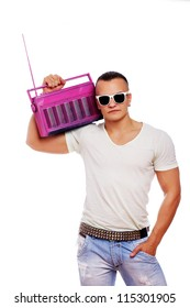 Portrait of muscle man posing in studio with radio