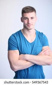 Portrait of muscle man posing in studio