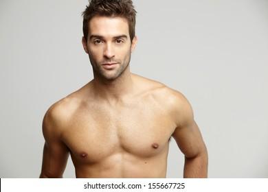 Portrait of muscular mid adult man, studio shot