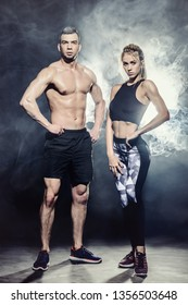 Portrait of muscular young people with beautiful athletic bodies. Fitness, bodybuilding. Health care.
