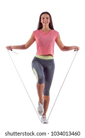 Portrait of muscular young woman exercising with jumping rope. Isolated on white background.