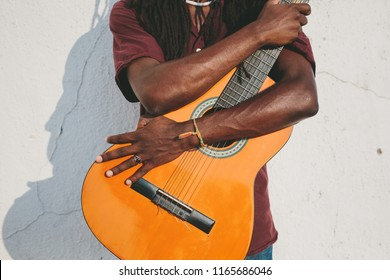 Portrait of musician African man holding guitar outdoor