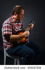 portrait of musician with mandolin , studio shot