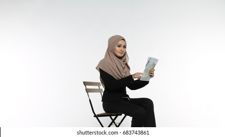 0709f4fcfe9a Portrait of Muslim Business woman executive reading map with face  expression isolated white background