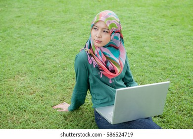 Portrait of muslim student with laptop