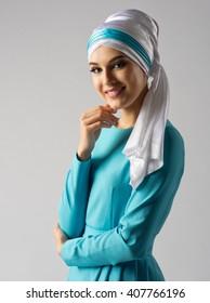 Portrait of muslim woman on grey
