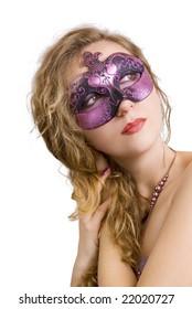 portrait of mysterious blond woman wearing purple stylish carnival mask