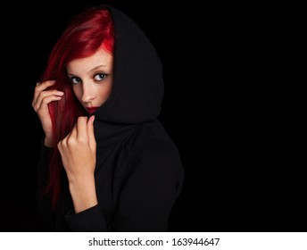 portrait of mysterious pretty woman at night