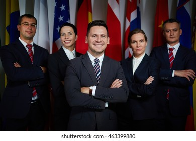 Portrait of national business team standing with arms crossed