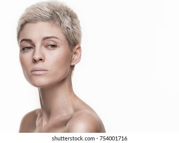 Portrait of natural beauty caucasian woman with short blonde hair and ideal skin.