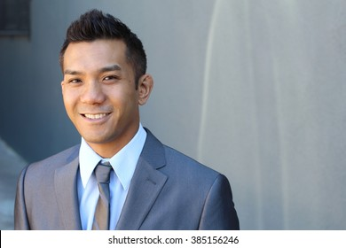 Portrait of a natural handsome classic Asian male with copy space on the right