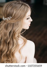 Portrait with natural light of pretty young woman with beautiful hairstyle decorated by stylish hair accessory