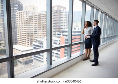 Portrait Of New Business Owners By Empty Office Window