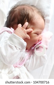 Portrait of a newborn baby girl.