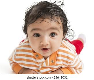 Portrait of a Newborn Baby Girl On Her Tummy, on white background