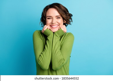 Portrait of nice attractive charming girl touch hands face enjoy weekend, wear green style stylish trendy clothes isolated over blue color background