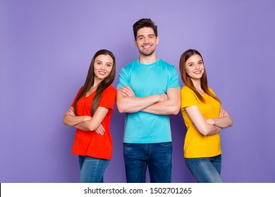 Portrait of nice attractive lovely charming cheerful cheery content guys wearing colorful t-shirts jeans denim supporting each other gathering teamwork isolated over violet lilac background