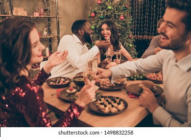 Portrait of nice attractive lovely glamorous gorgeous smart stylish cheerful cheery positive glad multinational guys having fun spending festal event romance date in decorated house room apartment