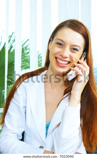 portrait of nice attractive young woman calling by cellular phone