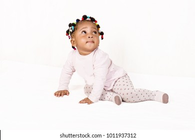 Portrait of a nice baby looking up isolated on a white background.