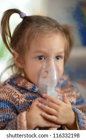 portrait of a nice baby makes inhalation home