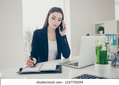 Portrait of nice beautiful attractive calm confident lady manager ceo boss chief in front of laptop netbook talking to partner writing everyday plan chatting at work place station