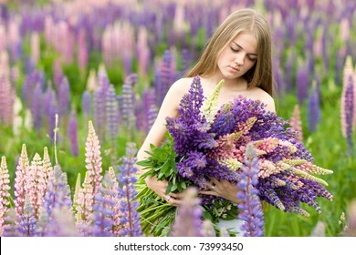 Portrait of nice beautiful girl in lupin field