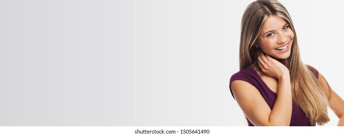 Portrait of a nice blond young woman , on white