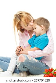 Portrait of nice boy (child, kid) with mother on white background , pretty woman and cute cheerful child play game; happy smiling young lady hugging son - family and mother`s day concept