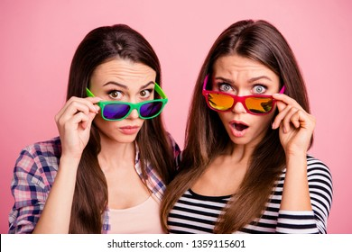 Portrait of nice charming students impressed by incredible information open mouth wearing eyewear eye glasses isolated fashionable clothing on pink background