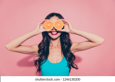 Portrait of nice cheerful cheery foolish glamorous lovely attractive adorable charming wavy-haired lady red lips covering closing eyes like glasses isolated on pink pastel background