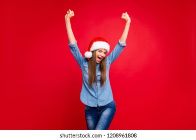 Portrait of nice cheerful funny positive attractive emotional girl wearing casual denim shirt jeans raising hands up isolated over red pastel background