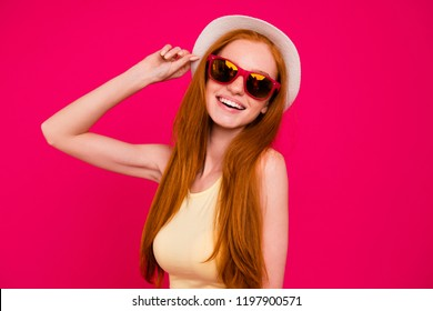 Portrait of nice cute attractive lovely adorable cheerful positive optimistic trendy pretty red-haired girl with long gold hair, touching headwear, isolated on bright vivid fuchsia background