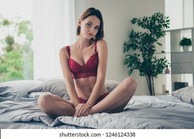Portrait of nice cute delicate gorgeous stunning feminine lovely sweet attractive girlish slim thin girl sitting on bed linen resting in modern light white interior room