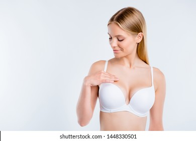 Portrait of nice dreamy attractive charming sweet perfect shape fit form curvy line girl touching breast plastic surgery salon procedure isolated over white light gray background