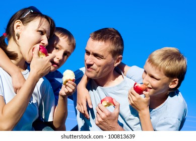 portrait of a nice family eating apples