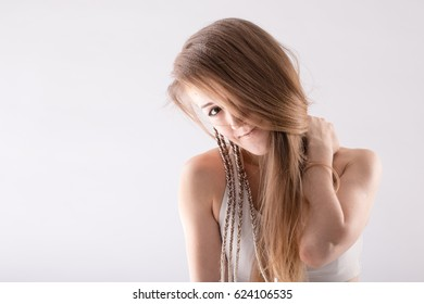 Portrait of a nice girl with long blonde hair