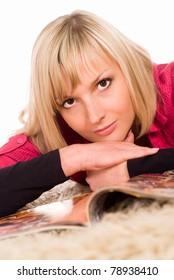 portrait of a nice girl lying on magazine