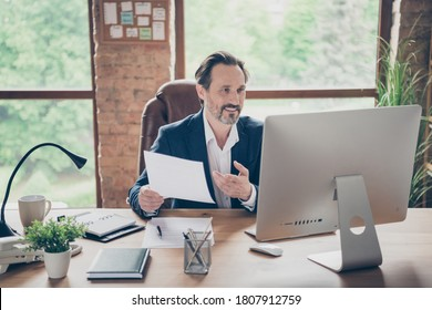 Portrait of nice handsome cheerful man specialist online appointment planning project start-up insurance sales global organization at modern loft brick industrial workplace workstation