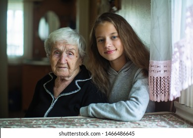 Portrait of nice little girl with old lady grandmother.