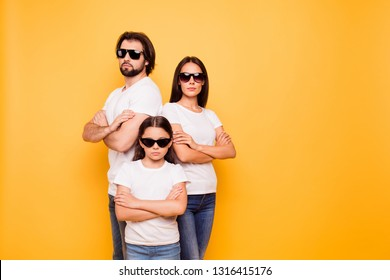 Portrait of nice lovely content attractive charming serious people company team wearing dark glasses standing together isolated over shine vivid pastel yellow background