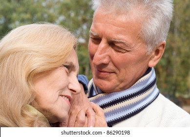 portrait of a nice old couple at nature