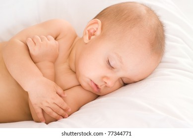 portrait of a nice sleeping baby on bed