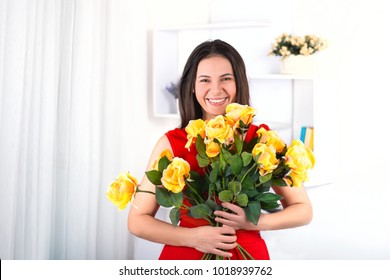 Portrait of the nice woman of the brunette with long hair. She stands 