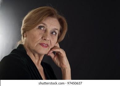 portrait nice  woman on a dark background