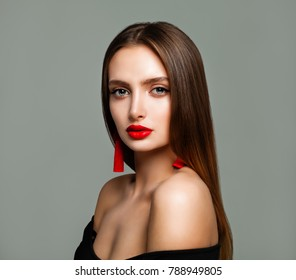 Portrait of Nice Woman with Red Lips Makeup and Earrings on Background with Copy space