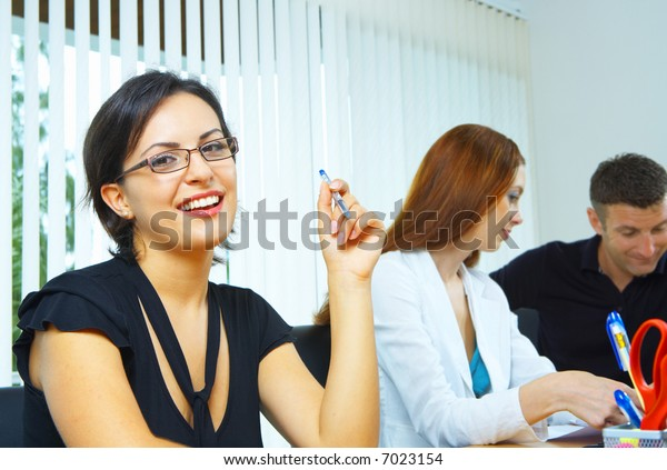Portrait of nice young businesswoman in office environment